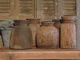 Oude houten Nepalese kruik